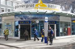 Tourists enter Gornergratbahn train station in Zermatt,Switzerland. Stock Photos
