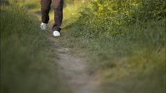 Young Girl is Walking on a Path Forward Stock Footage