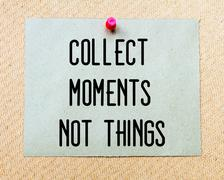 Collect Moments Not Thing  written on paper note pinned with red thumbtack Stock Photos