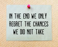In The End We Only Regret The Chances We Did Not Take written on paper note Stock Photos