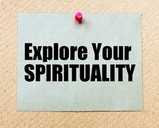 Stock Photo of Explore Your Spirituality written on paper note pinned with red thumbtack