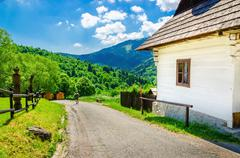 Wooden white hut in village, Eastern Europe Stock Photos
