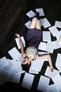 Girl posing in a dark room on the floor Stock Photos