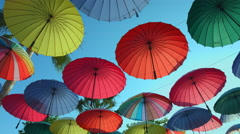 Many open in the sky umbrellas  give a guarantee that the rain will not spoil Stock Footage