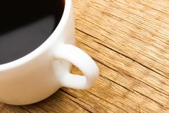 One cup of black coffee on neat table - stock photo