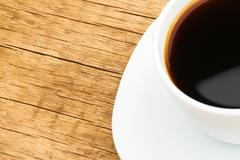 Stock Photo of One cup of black coffee on neat table - close up shot