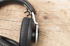 Vintage headphones on old wooden table - retro music concept Kuvituskuvat