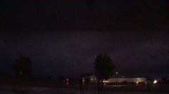 Distant lightning flashes in the sky as tornado warned storm approaches city Stock Footage