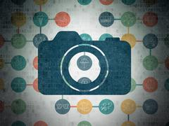 Tourism concept: Photo Camera on Digital Paper background - stock illustration
