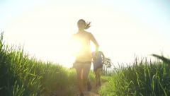 Slow Motion Couple Running Outside At Sunset Stock Footage