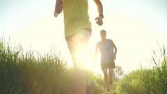 Active Couple Trail Running Outside At Sunset Stock Footage