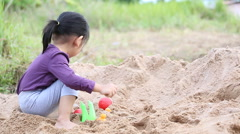 Asian children play sand Stock Footage