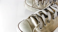 old sneakers on white background - stock footage