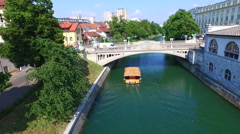 Aerial view of bridge and boat on the river Ljubljanica in Ljubljana, Slovenia Stock Footage