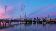 4k Dallas Skyline reflecting awesome purple clouds in Trinity River at dusk Stock Footage