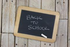 Small blackboard with white chalk - stock photo