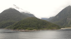 View of Milford Sound and mountain ranges, South Island, New Zealand Stock Footage