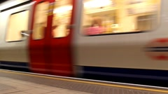 A subway train in motion arriving at a London underground train station. Stock Footage