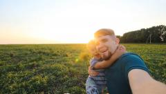 Father and son spending time together in sunny nature, taking selfies - stock footage