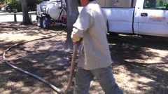 Hand watering trees in drought Stock Footage