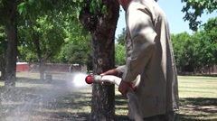Park worker in drought watering Stock Footage