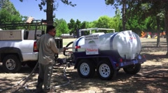 Drought watering from tank. Stock Footage