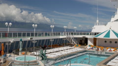 View of swimming pool area in cruise, Papeete, Tahiti, French Polynesia Stock Footage