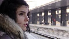 Sad and pensive woman waiting in the train station: winter time Stock Footage