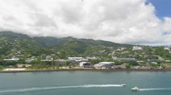 Stock Video Footage of View of motorboats in sea and commune of Papeete, Tahiti, French Polynesia