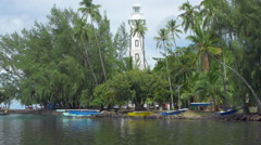 Canoes on coast near lighthouse in Point Venus, Papeete, Tahiti, French Stock Footage