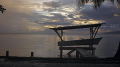 Boat kept in shed near dock at sunset, Papeete, Tahiti, French Polynesia Stock Footage