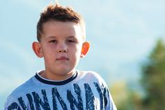 young boy posing outdoor at sunshine time - stock photo
