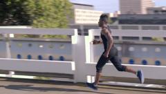 Man Runs Around The Top Level Of Parking Garage, Gorgeous City Views (4K) Stock Footage