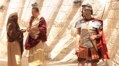 Stock Video Footage of Roman Leader Speaks with Citizen, Biblical Reenactment