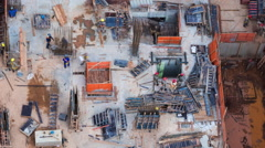 Timelapse View of Men Working at Construction Site Seen from Above - Zoom Out Stock Footage