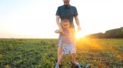 Family fun - father and his son up in the air Stock Footage