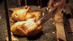 Chef cutting roast chicken in Gala Buffet, Ho Chi Minh, Vietnam Stock Footage