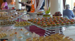 Various dessert kept on display in Gala Buffet, Ho Chi Minh, Vietnam - stock footage