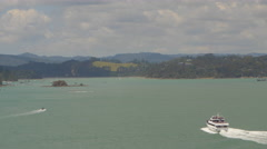 Ferry and sailboats sailing in sea near Bay of Islands, North Island, New Stock Footage