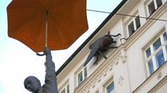 Slight Uncertainty: Michal Trpak Men With Umbrella; Art, Prague - stock footage