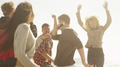 Happy group of multi ethnic friends dancing together on the beach Stock Footage