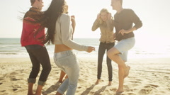 Stock Video Footage of Happy young latino woman dancing on the beach with group of multi ethnic friends
