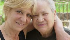 Old woman and mature woman portrait: family lifestyle footage Stock Footage