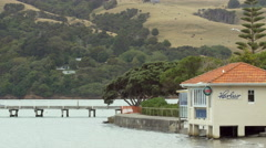 View of HarBar Beachfront Cafe at Akaroa, Christchurch, New Zealand Stock Footage
