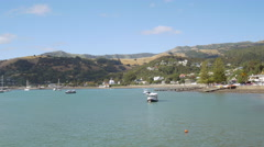 Stock Video Footage of Sail boat moored at dock in Akaroa, Christchurch, New Zealand