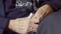Hands of an old woman: retired old woman, elderly wrinkled woman Stock Footage