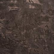 Creased brown cloth material fragment - stock photo