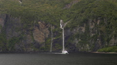 View of ferry boat sailing in Milford Sound, South Island, New Zealand Stock Footage