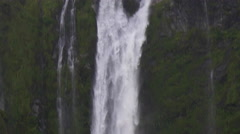 View of Stirling Falls and ferry boat below waterfall, South Island, New Zealand Stock Footage