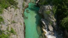 Aerial - High angle view of turquoise color river in gorge Stock Footage